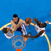 Anadolu Efes's Milko Bjelica (2ndL) during their Turkish Airlines Euroleague Basketball Top 16 Round 13 match Anadolu Efes between EA7 Emporio Armani Milan at Abdi ipekci arena in Istanbul, Turkey, Friday April 03, 2015. Photo by Aykut AKICI/TURKPIX