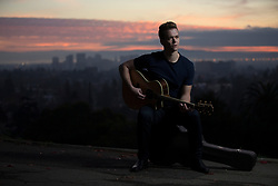 Singer/songwriter Ian Acredolo poses for a photograph at Mountain View Cemetery in Oakland, Calif., Thursday, Jan. 11, 2018. (Photo by D. Ross Cameron)