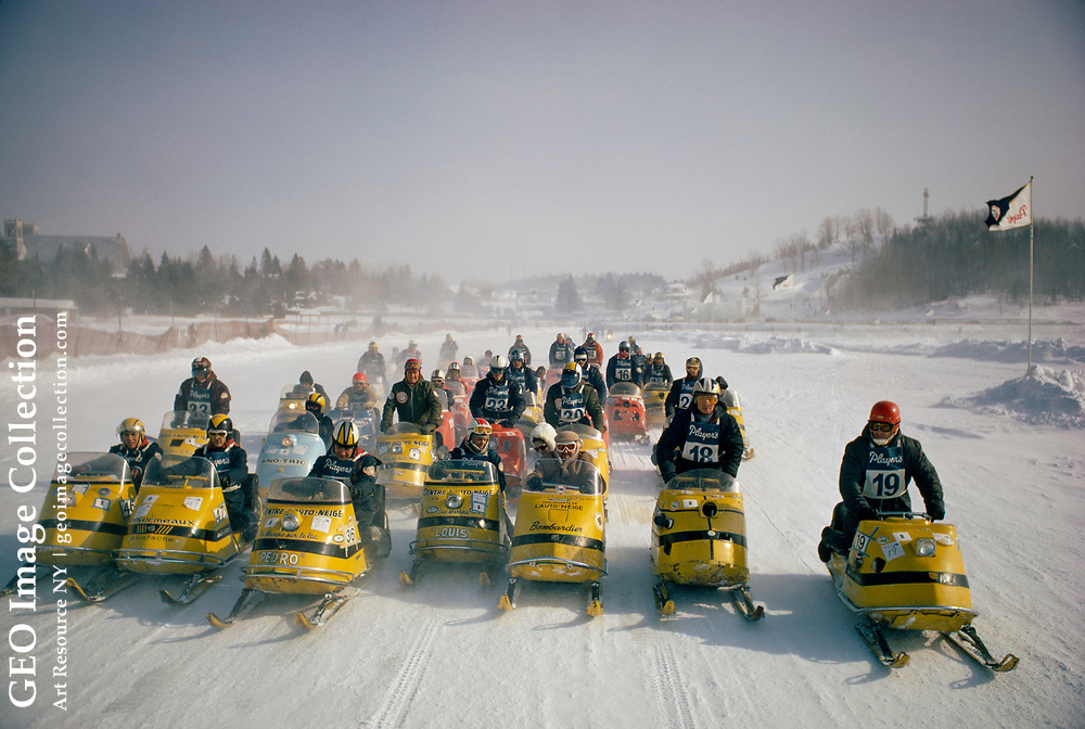 Snowmobiles take starting positions on a course at Saint Agathe.