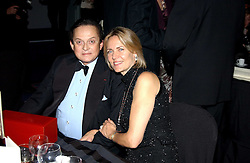 ALEC WILDENSTEIN and MRS ARNAUD BAMBERGER at the 2004 Cartier Racing Awards in association with the Daily Telegraph, held at the Four Seasons Hotel, London on 17th November 2004.<br />