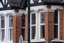 File photo dated 28/04/17 of a shattered window at the scene in Harlesden Road, London, after a woman was shot during an anti-terror raid. Armed police who shot and injured a woman in north London were not wearing bodycams, the police watchdog said.