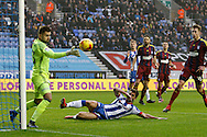Close call as Ipswich's keeper Bartosz Bialkowski (33) gets his fingers to the ball to turn it for a corner during the EFL Sky Bet Championship match between Wigan Athletic and Ipswich Town at the DW Stadium, Wigan, England on 17 December 2016. Photo by Craig Galloway.