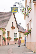 wrought iron sign old woman henri brecht eguisheim alsace france