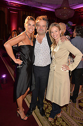 """Left to right, ASSIA WEBSTER, MARK HIX and MARISSA HERMER at the presentation of Le Prix Champagne De La Joie de Vivre to Stephen Webster in celebration of his long standing contribution to """"Joie de Vivre' held at the Council Room, One Great George Street, London on 22nd April 2015."""