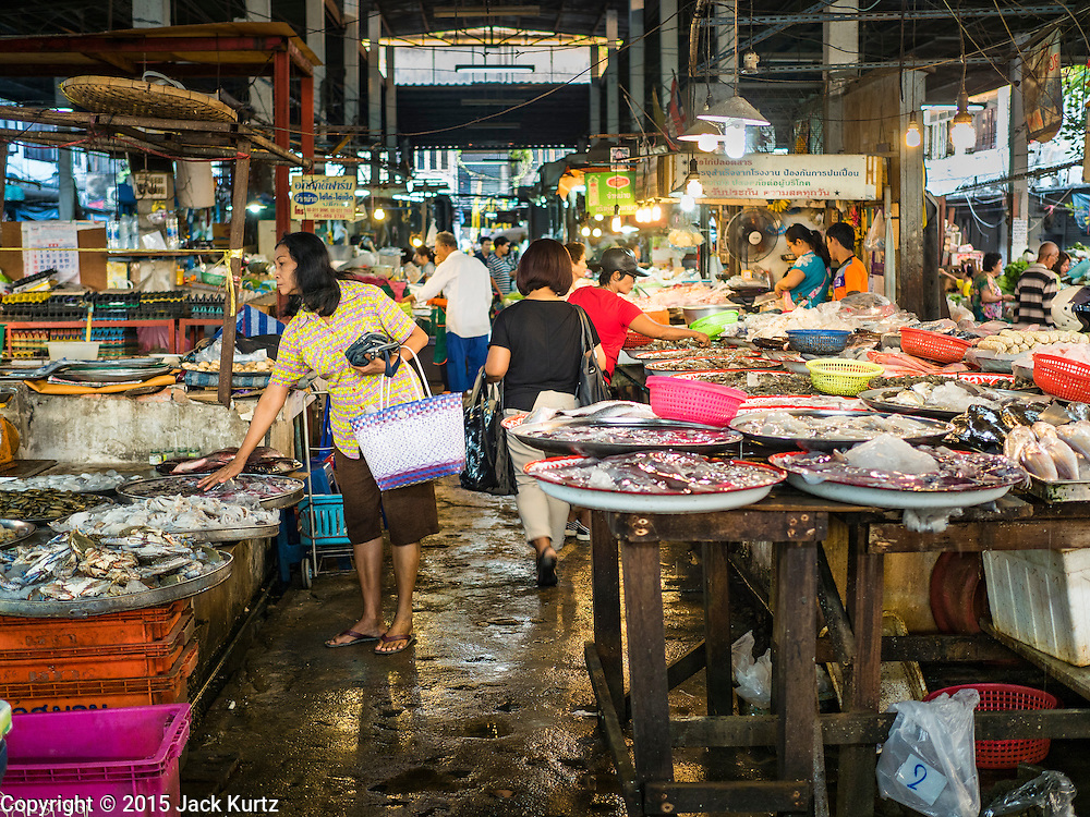 30 DECEMBER 2015 - BANGKOK, THAILAND:   People shop in Bang Chak Market. The market is supposed to close permanently on Dec 31, 2015. The Bang Chak Market serves the community around Sois 91-97 on Sukhumvit Road in the Bangkok suburbs. About half of the market has been torn down. Bangkok city authorities put up notices in late November that the market would be closed by January 1, 2016 and redevelopment would start shortly after that. Market vendors said condominiums are being built on the land.           PHOTO BY JACK KURTZ