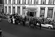 4/8/1964<br /> 8/4/1964<br /> 8 August 1964<br /> <br /> Mr. and Mrs. Gilley along with their party boarding the Coach to depart to Ballsbridge.<br /> Daimler Dart car
