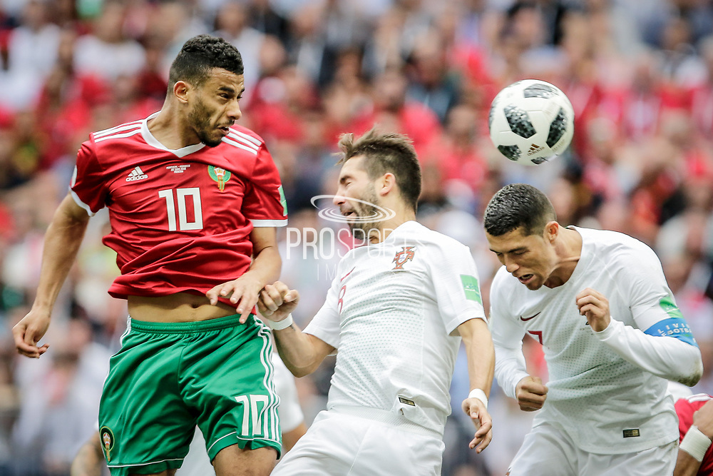 Younes Belhanda of Morocco in duel with Joao Moutinho and Cristiano Ronaldo of Portugal during the 2018 FIFA World Cup Russia, Group B football match between Portugal and Morocco on June 20, 2018 at Luzhniki stadium in Moscow, Russia - Photo Thiago Bernardes / FramePhoto / ProSportsImages / DPPI