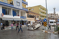 A Syrian car lays upside down in the main street of Reyhanli, Turkey. Between the site of two car bombings in the town this afternoon, shops and homes are in ruin and aggression towards Syrians grows