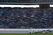 Kyle Busch (18), Martin Truex Jr. (56) and Jeff Gordon (24) battle for the lead during the Sprint Cup NRA 500 at Texas Motor Speedway in Fort Worth on Saturday, April 13, 2013. (Cooper Neill/The Dallas Morning News)