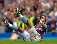 Photo: Daniel Hambury.<br />Chelsea v Aston Villa. The Barclays Premiership. 30/09/2006.<br />Villa's Juan Pablo Angel is left on his backside.