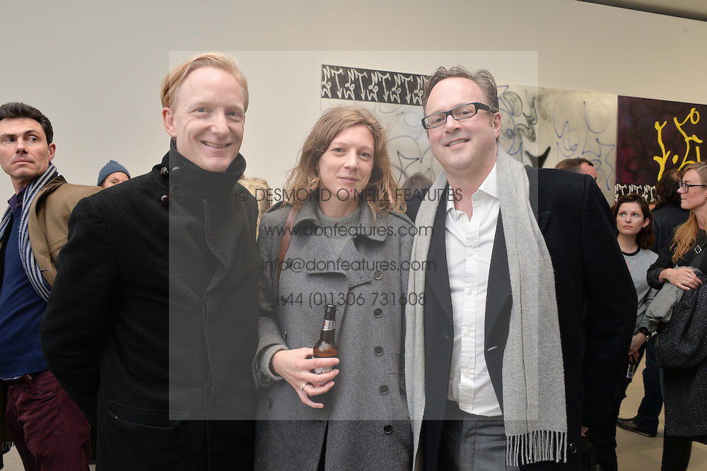 Left to right, CHARLES ASPREY, CARLA VON DER BECKE and SIR GEORGE SITWELL at a private view of Refraction. The Image of Sense held at Blain|Southern, Hanover Square, London on 9th December 2014.
