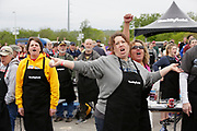 Kansas City Corporate Event Photographer- Weber Griillmaster Kevin Kolman, Kansas City Chiefs defensive end Chris Jones, Guinness World Records adjudicator Philip Robertson, and World Champion pitmaster Chris Lilly take part in Smithfield setting the Guinness World Records title for Largest grilling lesson on Thursday, April 27, 2017, in Kansas City, Mo. Colin E. Braley for Smithfield