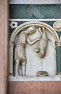 Late medieval relief sculpture depicting the labours for December with an animal being killed and astrological signs on the Facade of the Cattedrale di San Martino,  Duomo of Lucca, Tunscany, Italy, .<br /> <br /> Visit our ITALY HISTORIC PLACES PHOTO COLLECTION for more   photos of Italy to download or buy as prints https://funkystock.photoshelter.com/gallery-collection/2b-Pictures-Images-of-Italy-Photos-of-Italian-Historic-Landmark-Sites/C0000qxA2zGFjd_k<br /> <br /> <br /> Visit our MEDIEVAL PHOTO COLLECTIONS for more   photos  to download or buy as prints https://funkystock.photoshelter.com/gallery-collection/Medieval-Middle-Ages-Historic-Places-Arcaeological-Sites-Pictures-Images-of/C0000B5ZA54_WD0s .<br /> <br /> If you prefer to buy from our ALAMY PHOTO LIBRARY  Collection visit : https://www.alamy.com/portfolio/paul-williams-funkystock/lucca.html .