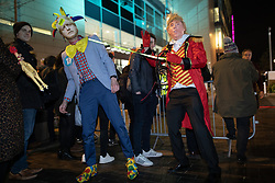 © Licensed to London News Pictures. 19/11/2019. Salford, UK. Protesters dressed as Donald Trump holding Boris Johnson on a leash outside the event . Conservative Party leader Boris Johnson and Labour Party leader Jeremy Corbyn attend a televised election hustings at ITV Studios at Media City as part of their respective campaigns to win the upcoming general election and become the next British Prime Minister . Photo credit: Joel Goodman/LNP