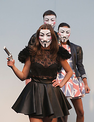 """© Licensed to London News Pictures. 21/04/2012. London, England. Models wearing """"V for Vendetta"""" masks whilst modelling designs by Charlotte Haggerty and Brett Le Bratt on the closing day of Alternative Fashion Week at London's Spitalfields Market. Photo credit: Bettina Strenske/LNP"""