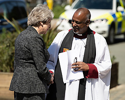 © Licensed to London News Pictures . 22/05/2018 . Manchester , UK . Prime Minster THERESA MAY arrives and is greeted by Dean ROGERS GOVENDER at Manchester Cathedral for a Service of Remembrance on the first anniversary of the Manchester Arena bombing . On the evening of 22nd May 2017 , Salman Abedi murdered 22 people and seriously injured dozens more , when he exploded a bomb in the  foyer of the Manchester Arena as concert-goers were leaving an Ariana Grande gig . Photo credit : Joel Goodman/LNP
