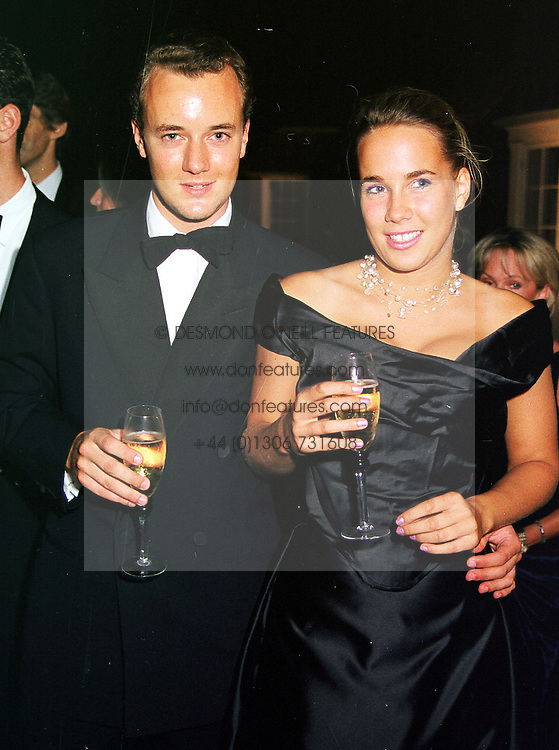 The MARQUESS OF BRISTOL and MISS VERITY EVETTS, at a party in Oxfordshire on 11th September 1999.MWE 84