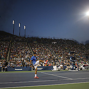 Roger Federer, Switzerland, kicks the ball away after missing a shot during his loss to Tommy Robredo, Spain, on Louis Armstrong Stadium during the Men's Singles competition at the US Open. Flushing. New York, USA. 2nd September 2013. Photo Tim Clayton