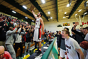 Rutland's Keegan Bliss (24) holds up the trophy to the fans during the Vermont state division I boys basketball championship game between the Mount Mansfield Cougars and the Rutland Raiders at Patrick Gym on Saturday afternoon March 17, 2018 in Burlington. (BRIAN JENKINS/for the FREE PRESS)