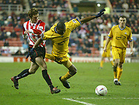 Photo. Andrew Unwin.<br /> Sunderland v Preston North End, Nationwide League Division One, Stadium of Light, Sunderland 11/03/2004.<br /> Sunderland's George McCartney (l) brings down Preston's Ricardo Fuller (c) just outside the penalty area.