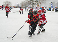 Broots Magoots of Manchester and The Pylons from Chelmsford, MA take to the ice for day one of the New England Pond Hockey Classic at Meredith Bay.  (Karen Bobotas/for the Laconia Daily Sun)