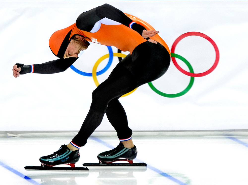 Rusland, Sochi, 10-02-2014.<br /> Olympische Winterspelen, Schaatsen, 500 meter, mannen.<br /> Michel Mulder gooit z'n schaats naar voren op de finihlijn. Hij wint goud.<br /> Foto: Klaas Jan van der Weij