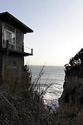house on edge of rock on Enoshima island Japan