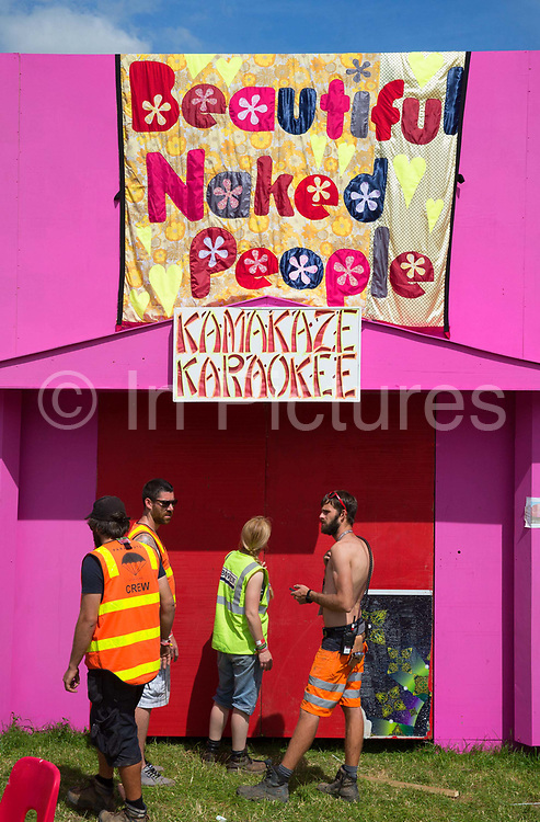 """Glastonbury Festival, 2015. Shangri La is a festival of contemporary performing arts held each year within Glastonbury Festival. The theme for the 2015 Shangri La was Protest. Building a karaokee booth.<br /> """"Beautiful Naked People ... bring a banging noisy party to Shangri-La. Lose yourself and maybe your clothes, in true kamikaze karaoke style. Sing along a power protest song! Vote for nobody, just get naked!"""""""