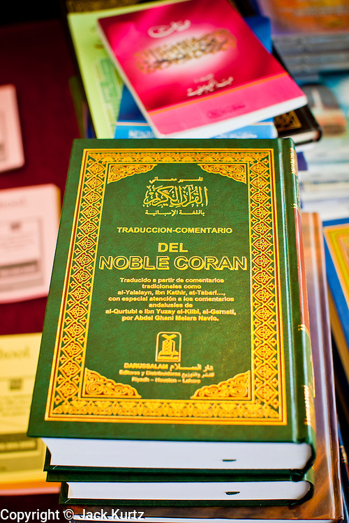"""Sept. 10 - GLENDALE, AZ: Spanish language Qurans (also called Korans) available in the Glendale Civic Center before Eid ul-Fitr services. Muslims from the Phoenix area celebrated Eid ul-Fitr, the end of Ramadan, at the Glendale Civic Center in Glendale, AZ, a suburb of Phoenix. Eid ul-Fitr, often abbreviated to Eid, is the Muslim holiday that marks the end of Ramadan, the Islamic holy month of fasting. Eid is an Arabic word meaning """"festivity"""", while Fitr means """"conclusion of the fast""""; and so the holiday symbolizes the celebration of the conclusion of the month of fasting from dawn to sunset during the entire month of Ramadan. The first day of Eid, therefore, is the first day of the month Shawwal that comes after Ramadan.  Photo by Jack Kurtz"""