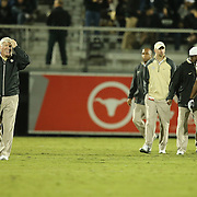 UCF head coach Goerge O'Leary (left) reacts to the scoreboard after falling behind during an NCAA football game between the South Florida Bulls and the 17th ranked University of Central Florida Knights at Bright House Networks Stadium on Friday, November 29, 2013 in Orlando, Florida. (AP Photo/Alex Menendez)