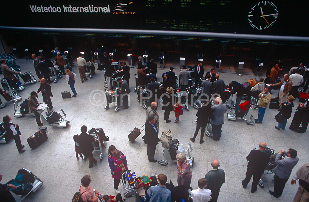 Passengers mingle at the Eurostar terminal at Londons Waterloo Station in the 1990s before it was moved to St. Pancras, on 16th September 1996, in London, England.