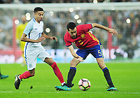 Football - 2016 / 2017 International Friendly - England vs. Spain<br /> <br /> Sergio Busquets of Spain and Jesse Lingard of England at Wembley.<br /> <br /> COLORSPORT/ANDREW COWIE
