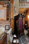 confessional in a baroque style church Rome Italy