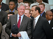 President Bill Clinton talks with New York Yankees baseball manager Joe Torre  as the 1998 World Series winning Yankees visited the White House June 10, 1999 in Washington, DC.