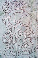 Viking art on Rune stone outside Taby, Uppland, Sweden