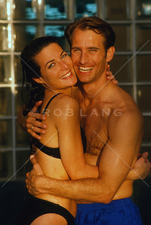 Couple just out of a swimming pool embracing