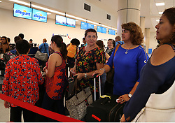 Raquel Delgado (center) accompanies her mother Ana Raquel Rodriguez, who is leaving Puerto Rico to Orlando (for and indefinite time while the island's improves) at the Luis Marin Muñoz airport in San Juan as the airport's conditions improves after Hurricane Maria, (category 4) passed through Puerto Rico devastating the island leaving residents without power on Sept 20. on October 02, 2017. Photo by Pedro Portal/Miami Herald/TNS/ABACAPRESS.COM