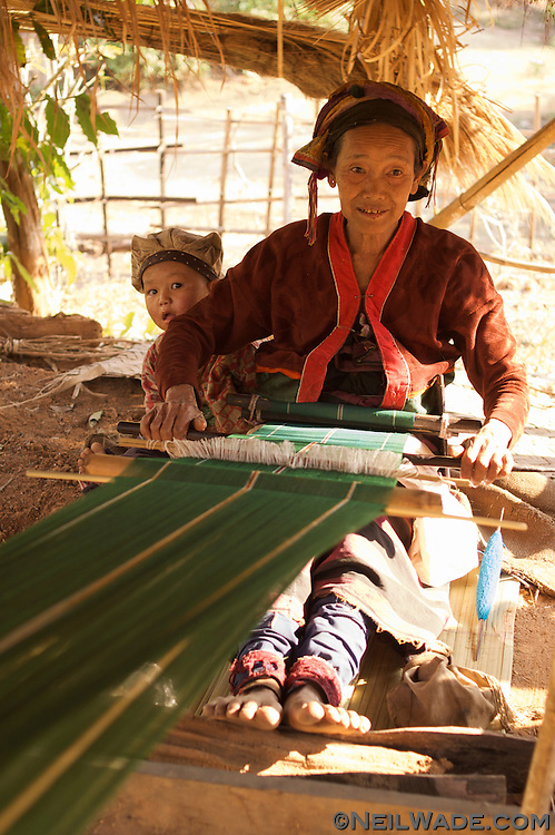 A woman makes fabric on an old loom in Hspaw, Burma.