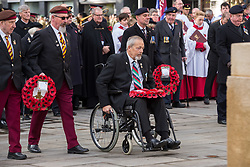 © Licensed to London News Pictures. 10/11/2019. Bristol, UK. Remembrance Day parade and wreath laying at the Cenotaph in Bristol city centre. Picture of a disabled veteran laying wreaths. Photo credit: Simon Chapman/LNP.