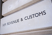 HM Revenue and Customs sign on Whitehall on 11th August 2021 in London, United Kingdom. HM Revenue & Customs also known as HMRC is in charge of all elelments of tax and taxation as well as administering corporation tax, excise duties, national minimum wage enforcement, recovery of student loans, child benefit etc.