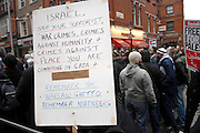 London 04/01/09: Protests outside the Israeli Embassy in London UK: A clear message is held up towards the embassy