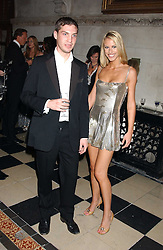WILLIAM AITKEN and PETRINA KHASHOGGI at Andy & Patti Wong's annual Chinese New Year party, this year celebrating the year of the dog held at The Royal Courts of Justice, The Strand, London WC2 on 28th January 2006.<br /><br />NON EXCLUSIVE - WORLD RIGHTS