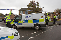 © Licensed to London News Pictures . 23/10/2014 . Penistone , UK . Police lift a cordon to allow a Crime Scene Investigation van through . A fire in a house on Tennyson Close in Penistone near Barnsley has killed a nine year old boy and a 44 year old man and a boy aged 11 is critically ill in hospital . The house is cordoned off by police . Photo credit : Joel Goodman/LNP