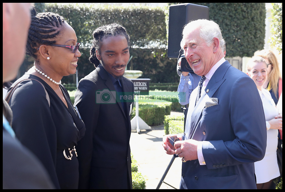 April 18, 2018 - London, London, United Kingdom - Prince Charles attends CHOGM London 2018. Prince Charles, Prince of Wales, President of The Prince's Trust Group, speaks with Tafari Crick-McClean (C) as he hosts a reception for The Prince's Trust International during the Commonwealth Heads of Government Meeting at Clarence House Gardens on April 18, 2018 in London, England. (Credit Image: © i-Images via ZUMA Press)