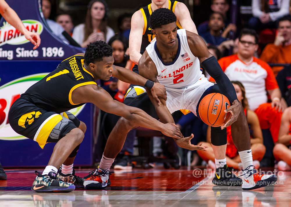 CHAMPAIGN, IL - MARCH 08: Joe Toussaint #1 of the Iowa Hawkeyes and Kipper Nichols #2 of the Illinois Fighting Illini reach for the ball during the game at State Farm Center on March 8, 2020 in Champaign, Illinois. (Photo by Michael Hickey/Getty Images) *** Local Caption *** Joe Toussaint; Kipper Nichols