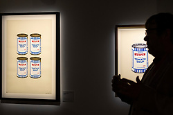 """© Licensed to London News Pictures. 18/05/2021. LONDON, UK. """"Soup Cans"""", 2003, by Banksy. Preview of """"The Art of Banksy"""" at Seven Dials, Covent Garden. Over 100 pieces of Banksy's works are on display from private collections across the globe and it is the first time the world's largest touring exhibition of authentic Banksy Artworks has come to the UK, deferred from 2020 due to the coronavirus pandemic but opening now as lockdown restrictions are eased.  The show runs 20 May to 21 November 2021.  Photo credit: Stephen Chung/LNP"""