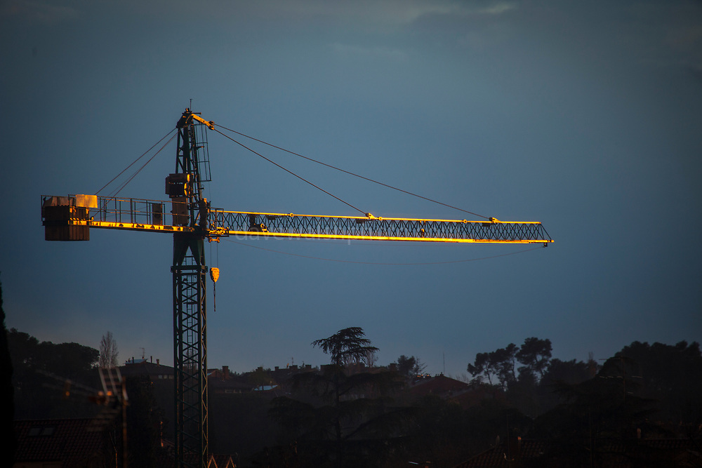 """Golden construction crane. Sant Cugat del Valles, Barcelona, Catalonia This mage can be licensed via Millennium Images. Contact me for more details, or email mail@milim.com For prints, contact me, or click """"add to cart"""" to some standard print options."""