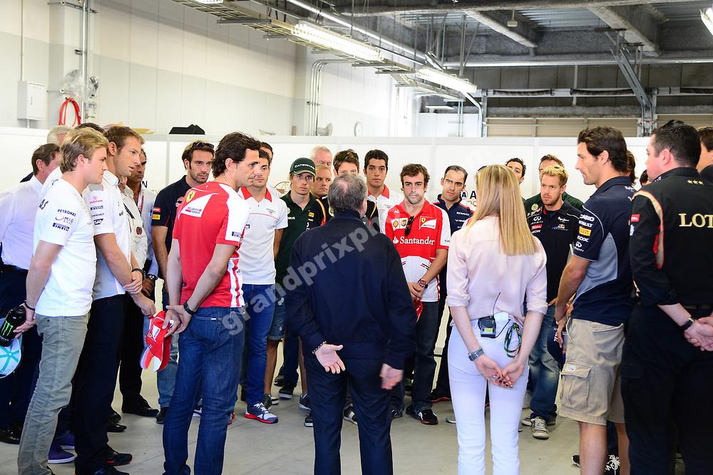 Drivers, team principals and FIA president Jean Todt observe one minute´s silince in honour of Maria de Villota before 2013 Japanese Grand Prix in Suzuka. Photo: Grand Prix Photo