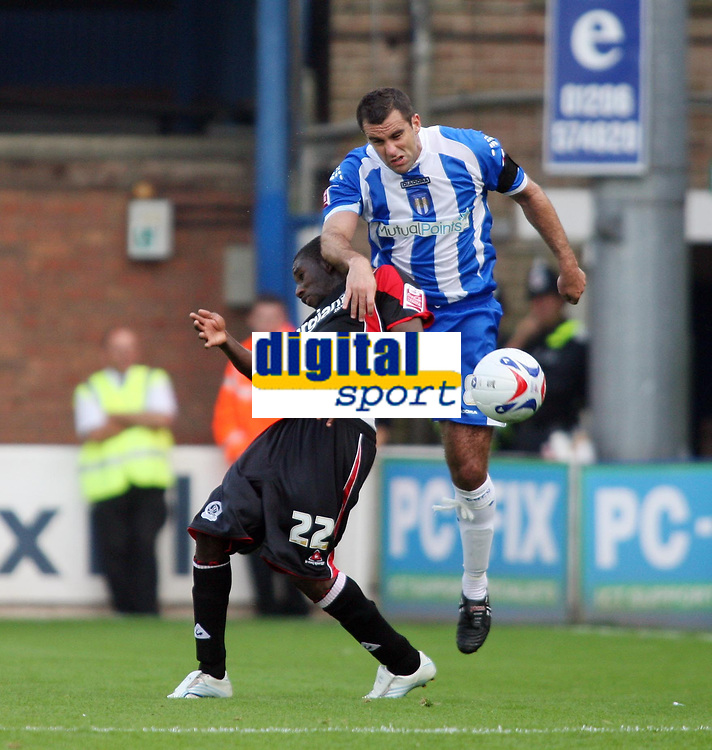 Photo: Chris Ratcliffe.<br />Colchester United v Queens Park Rangers. Coca Cola Championship. 16/09/2006.<br />Shabazz Baidoo (L) of QPR clashes with Chris Barker of Colchester United.