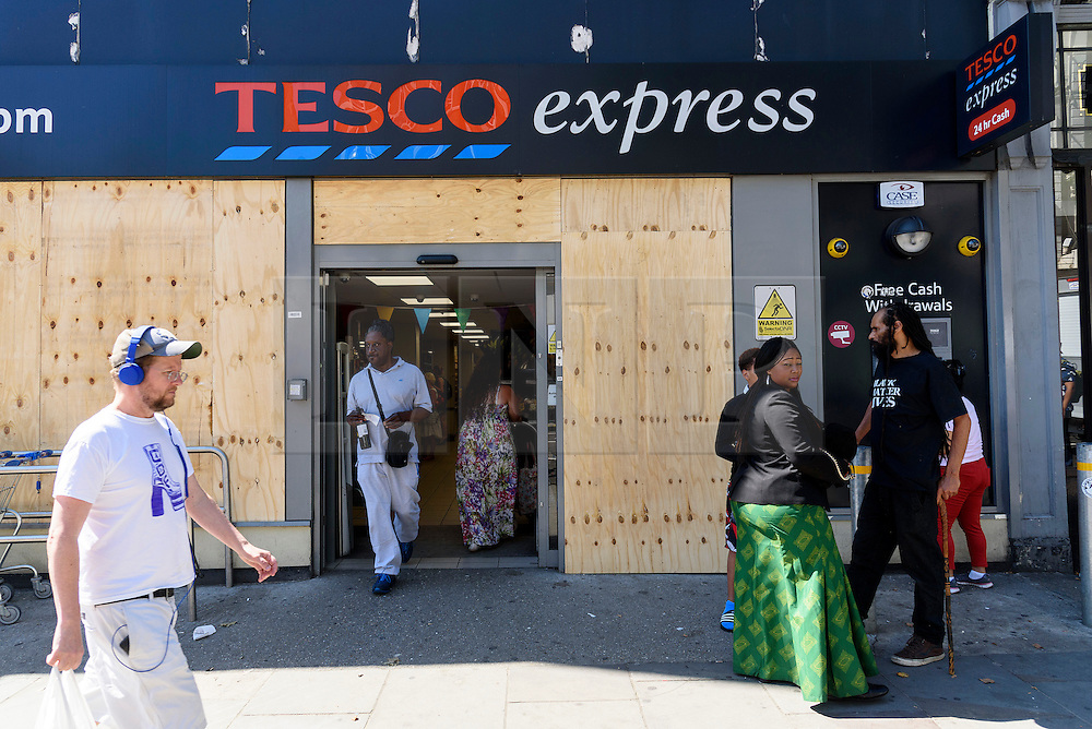 © Licensed to London News Pictures. 26/08/2016.  Tesco supermarket store is boarded up in Notting Hill ahead of the annual Notting Hill Carnival which starts this bank holiday weekend.  London, UK. Photo credit: Ray Tang/LNP